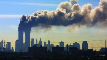 Smoke billows from the twin towers of the World Trade Centre in New York after aeroplanes crashed into both towers on September 11, 2001.