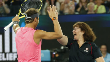 Deb Borg plays tennis alongside Rafael Nadal at Wednesday night's Rally for Relief.