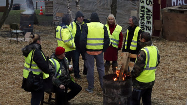 Protesters wearing yellow vests gather in a makeshift camp on a roundabout near Senlis, north of Paris, on Thursday.