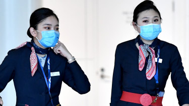 China Eastern Airlines cabin crew are seen wearing protective face masks at Brisbane International Airport.