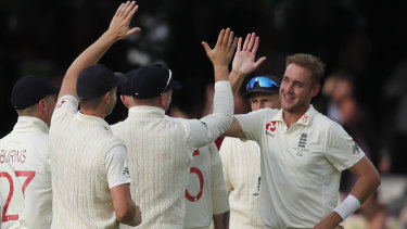 Stuart Broad, right, celebrates taking the wicket of David Warner.
