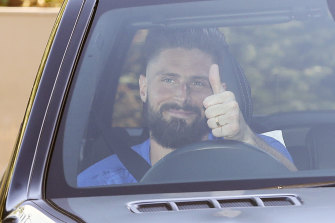 Chelsea's Olivier Giroud gives the thumbs-up as he left the club training centre this week.