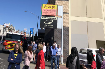 Fire trucks arrive at the Rivoli Cinema in Camberwell as people evacuate during a preview screening of Frozen 2.