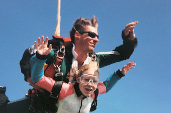 Kirsty Everett pictured skydiving in Cairns at 16 years old.
