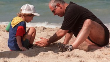 Israeli Prime Minister Benjamin Netanyahu plays in the sand with his son Yair at the beach in 1997.