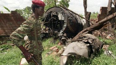 A Rwandan Patriotic Front rebel walks by the plane wreckage in which Rwanda's President Juvenal Habyarimana died on April 6, 1994, in Kigali.