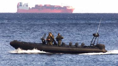 An Australian vessel patrols the waters near the Norwegian ship Tampa in 2001.