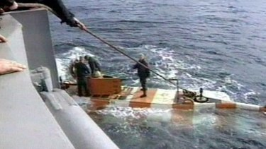 In this video grab provided by the RU-RTR Russian television via APTN , Russia rescue personnel return from a dive in a mini submarine to the Kursk on the sea bed in the Barents Sea.