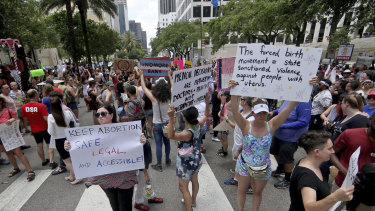Hundreds of abortion-rights advocates block Poydras Street outside One Shell Square to protest anti-abortion legislation in New Orleans.