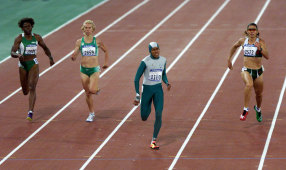 Cathy Freeman hits the front in the 400-metre final.