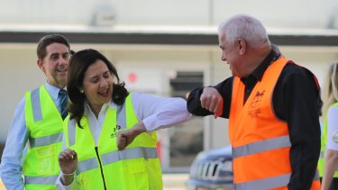 Sign of the times: Annastacia Palaszczuk  does the pandemic shake on day one of the election campaign