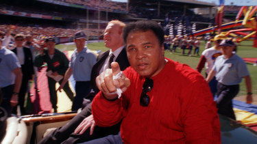 The greatest: Muhammad Ali completed a lap of honour on grand final day at the MCG in 1998.