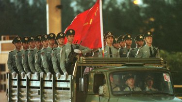 Chinese troops enter at the Luk Ma Chau border between China and Hong Kong in the New Territories to take up positions in China's newly reclaimed territory in July 1997.