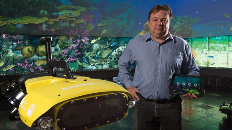 Professor Matthew Dunbabin with the RangerBot at the Queensland University of Technology.