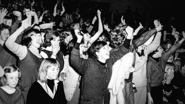 Crowds scream in delight as the Beatles perform at Sydney Stadium, 18 June, 1964.