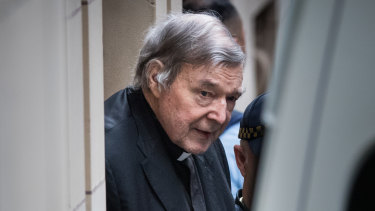 George Pell leaving Melbourne's Supreme Court building in August.