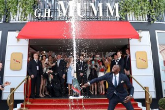 Olympic champion Usain Bolt setting off a 'champagne shower' at last year's Cup.