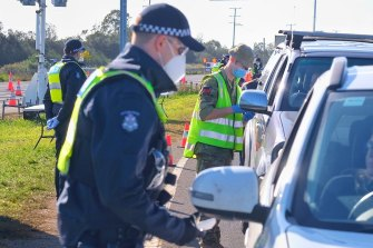Police and ADF personnel at a checkpoint on Melbourne's outskirts in July last year.