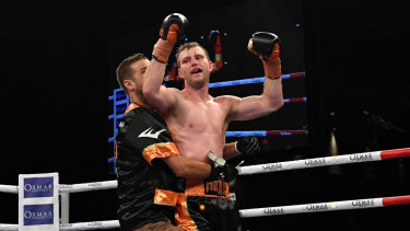 Ben Horn embraces Jeff Horn following his first title defence.