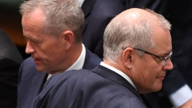 Prime Minister Scott Morrison (right) crosses paths with Opposition Leader Bill Shorten at Parliament House.