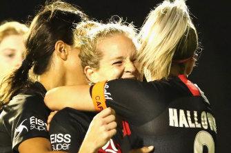 Kristen Hamilton celebrates her equaliser for the Wanderers.