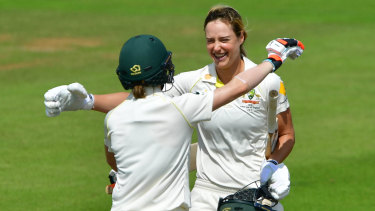 Ton of talent: Australia's Ellyse Perry (right) celebrates her 100 with Racheal Haynes.
