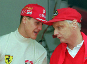Ferrari consultant Niki Lauda chats with defending champion Michael Schumacher of Germany, left, during the practice session for the Monaco F1 Grand Prix , May, 1996.