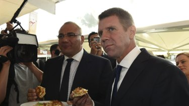 Mike Baird, at the time Premier, on the 2015 campaign trail in Auburn with the Liberal Party's then candidate Ronney Oueik, a former Auburn councillor.