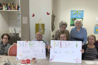"Residents show posters reading ""Thank you for everything""."