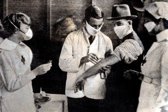 Inoculation at a special depot in Hyde Park in February 1919, at the height of the influenza epidemic in Sydney.