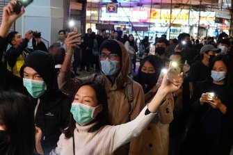 People raise their cellphones lights as they form a human chain on New Year's eve in Hong Kong.