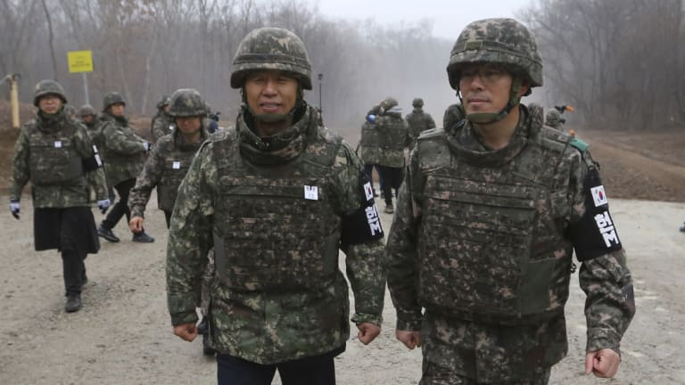South Korean Gangwon Province Governor Choi Moon-soon, centre left, is escorted by South Korean army soldiers as he visits the DMZ this week.