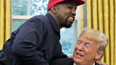 Rapper Kanye West shakes hands with US President Donald Trump during a meeting in the Oval Office.