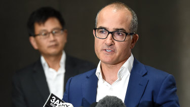 Acting Premier James Merlino announces the new date for hotel quarantine to restart. Behind him is Deputy Chief Health Officer Allen Cheng.