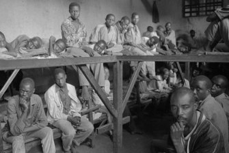 Inmates accused of war crimes sit in a prison at Kibungo in August 1994. Survivors of the Rwandan genocide say reconciliation cannot be achieved whilst those convicted of war crimes refuse to provide information about burial sites.