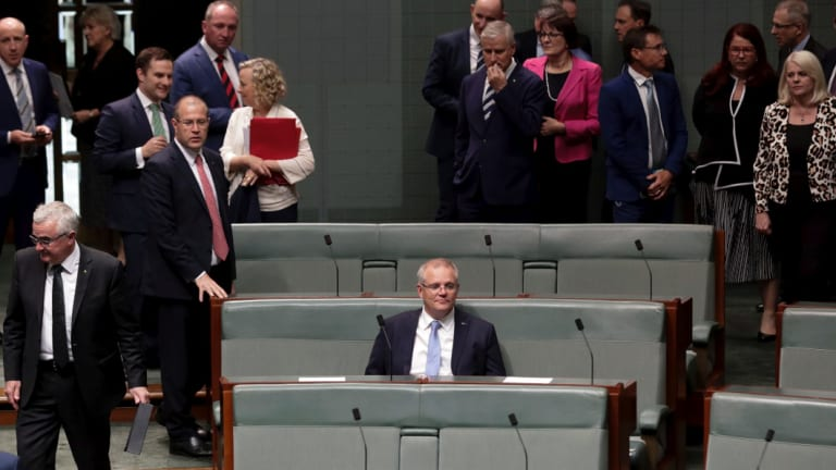 Lonely at the top: Prime Minister Scott Morrison during debate in the House of Representatives at Parliament House in Canberra on  Thursday.