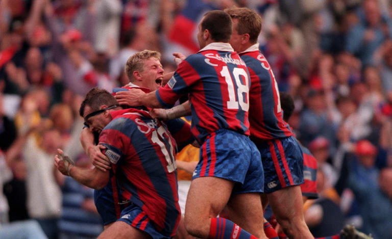 Prince Albert: Darren Albert and the Knights celebrate an improbable grand final victory in 1997.
