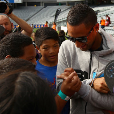 Benji Marshall is mobbed by young fans when he returned home to New Zealand for a Test match in 2012.