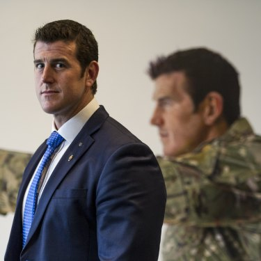Ben Roberts-Smith pictured in front of a portrait.
