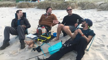Recovering after a day of paddling: (from left) Trevor Potts, Simon Moroney, Joe McNamara and Ollie Roffey.