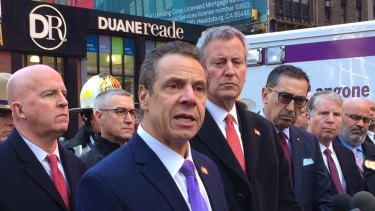 New York Governor Andrew Cuomo, left wearing a purple tie, and New York City Mayor Bill de Blasio, right, originally applauded Amazon's decision to open a new headquarters in Queens.