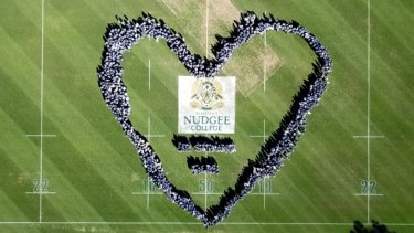 Students from Brisbane's St Joseph's Nudgee College show their support for Alexander Clarke.