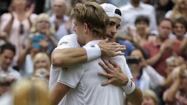 South Africa's Kevin Anderson hugs John Isner of the United States, right, after the longest Wimbledon semi-final in history.