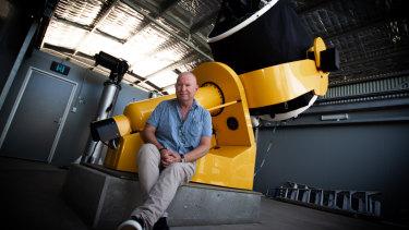UWA associate professor David Coward with the uni's Zadko telescope in Gingin.