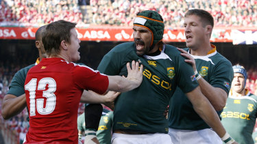 South Africa's Bakkies Botha, right and Victor Matfield, center, tussle with Brian O'Driscoll at Loftus Versfeld in 2009.
