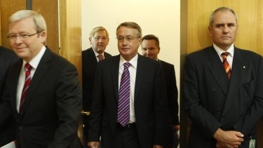 Treasury secretary Ken Henry (right), Prime Minister Kevin Rudd and Treasurer Wayne Swan in 2010.