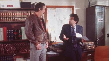 Darryl Kerrigan (Michael Caton) and his attorney Dennis Denuto (Tiriel Mora).