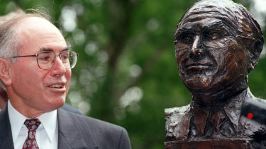 John Howard with his bust in Ballarat in 1997.