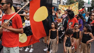 Protesters march through Redfern on Australia Day to protest celebrating on January 26.