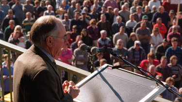 Prime Minister John Howard addresses a gun rally wearing a bulletproof vest.
